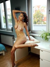 Czech darling slinks mischievously around her apartment