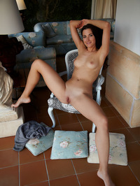 Stunning Lauren Crist sits on a high-backed chair