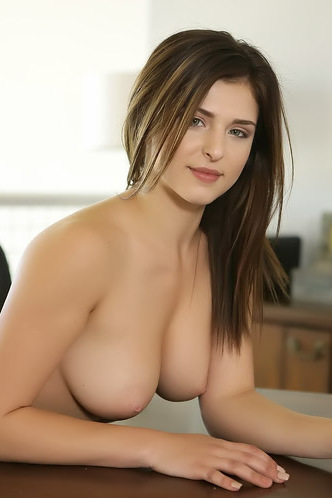 Leah Gotti Poses On A Table